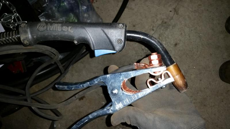 Name:  miller 211 gun clamp.jpg